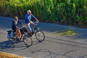 Elderly Couple Cycling Electric Bikes